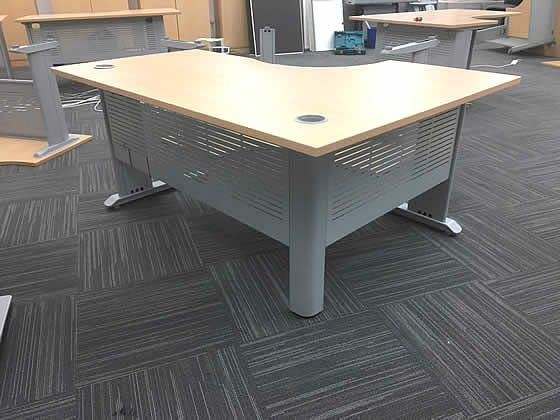 Further view of the corner desks shown in previous images