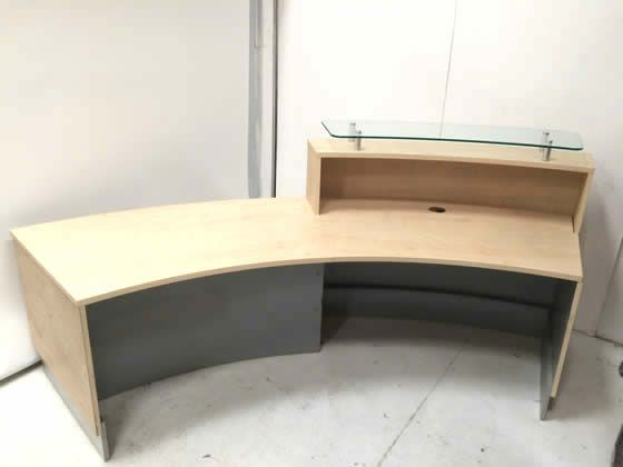 Further view of the curved maple reception desk shown in the previous image.