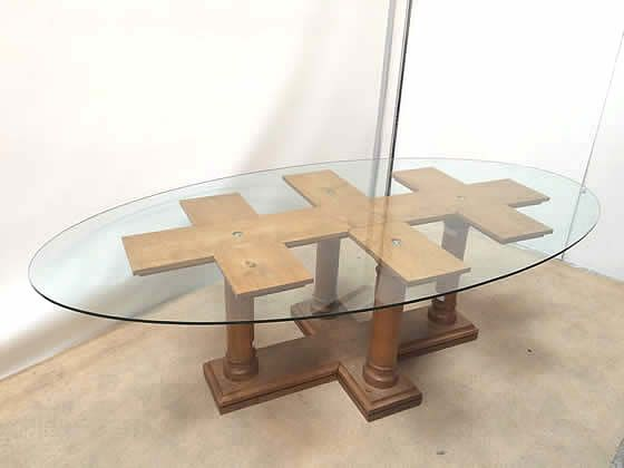 Oval glass top table with reproduction style wooden base.