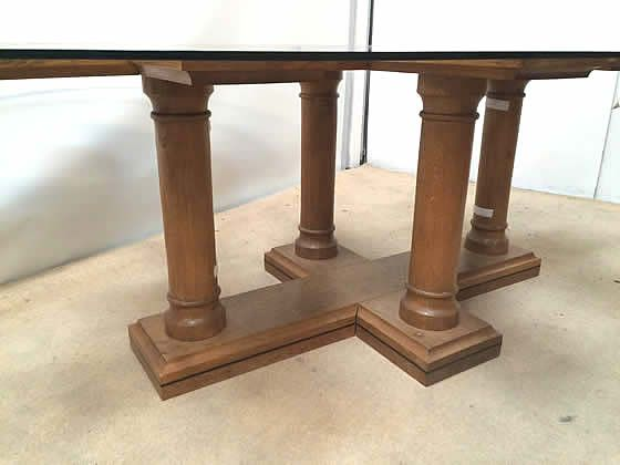 Further image of the glass top table shown in the previous image showing the wooden base.