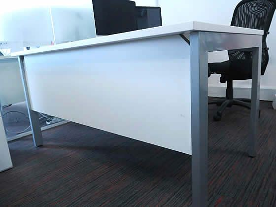 Further view of the white 1400mm desks shown in the previous image.