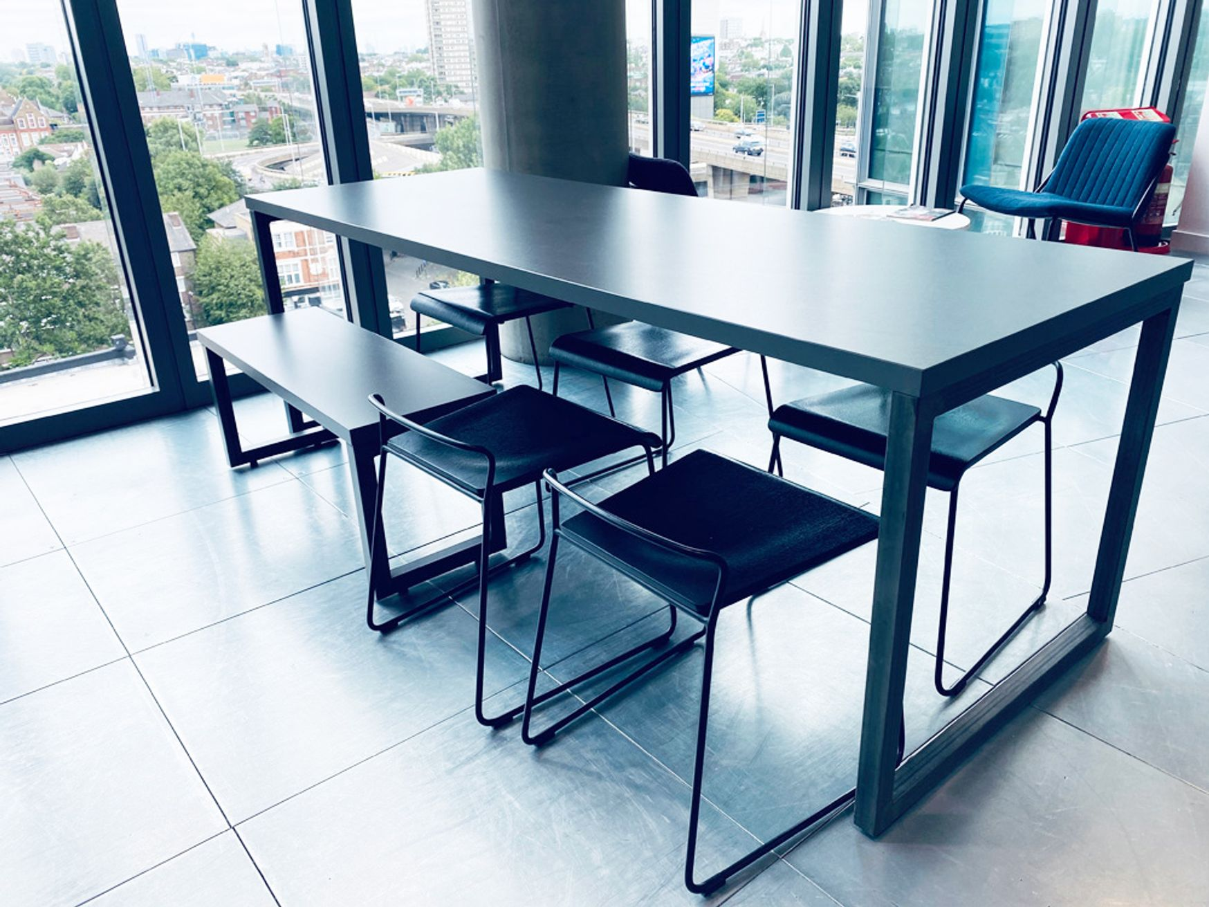 Urban style used 'Mix' cafe tables with grey tops and raw steel legs