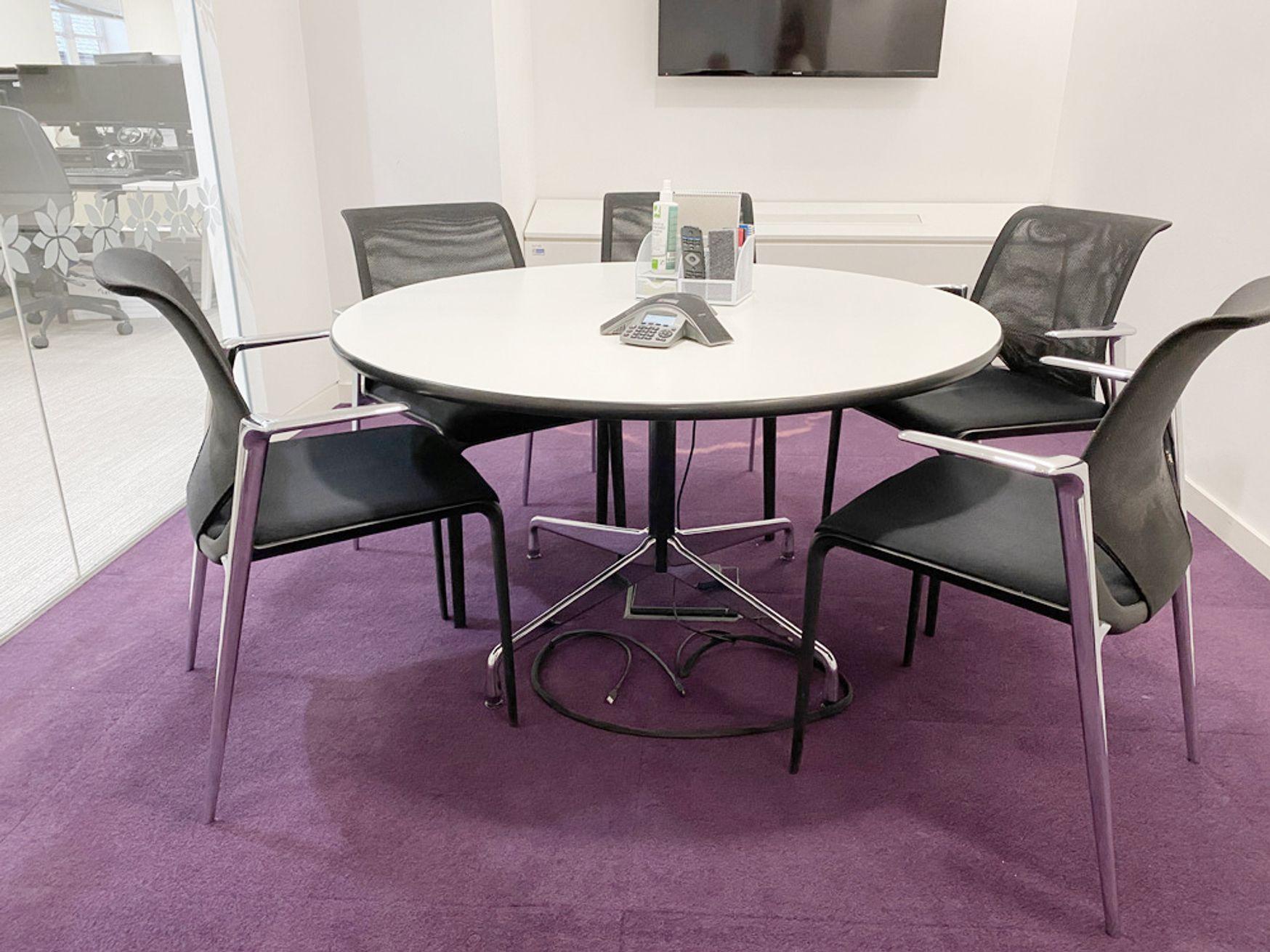 Used Vitra/Eames 'Segmented Table' with white laminate top, black edge.