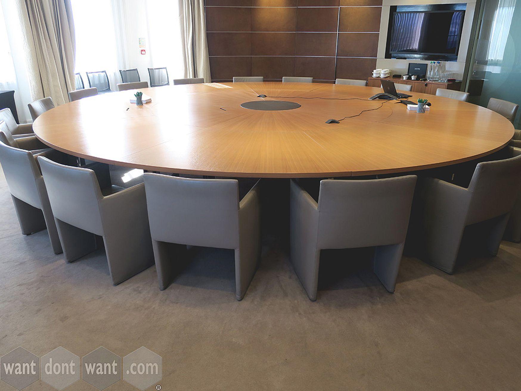 An imposing used 20-seat bespoke circular boardroom table
