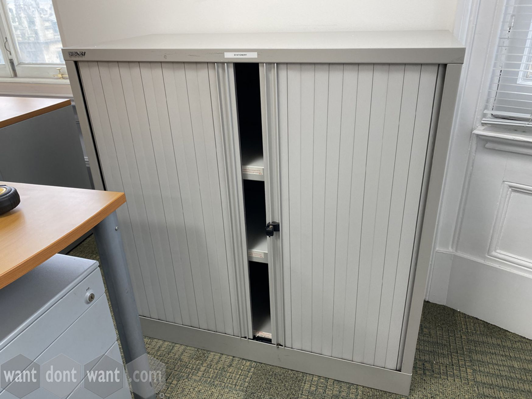 Used Bisley side tambour-door unit with shelves. 1000mm wide x 1020mm high