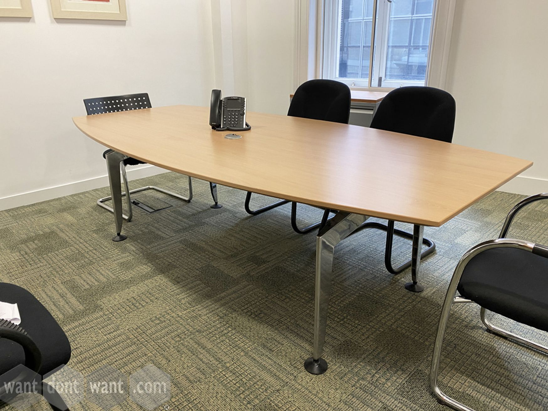 Used barrel-shaped meeting table with contemporary style chrome legs. 2400mm x 1200mm