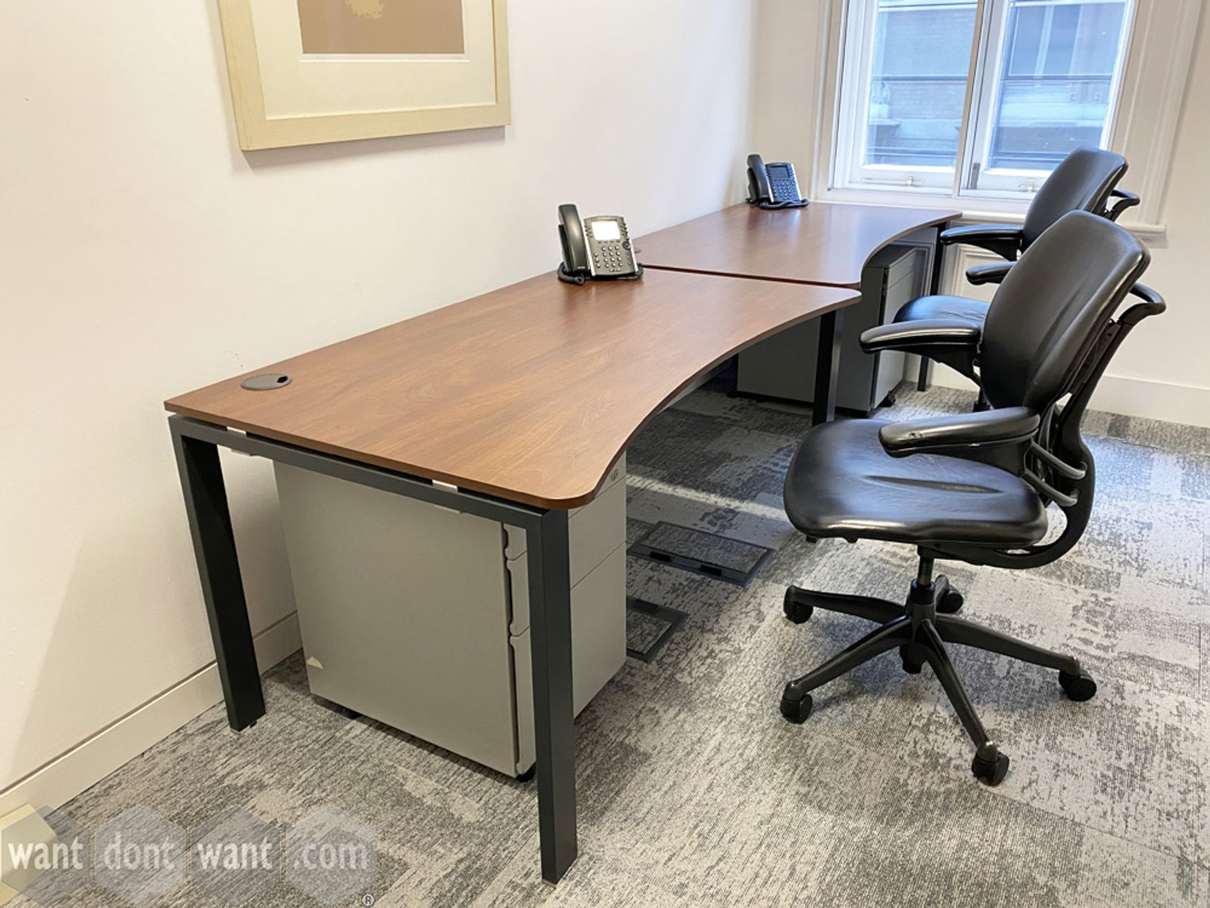 Used double wave-shaped free-standing desks with walnut MFC tops and black frames. 1400mm w x 800mm d