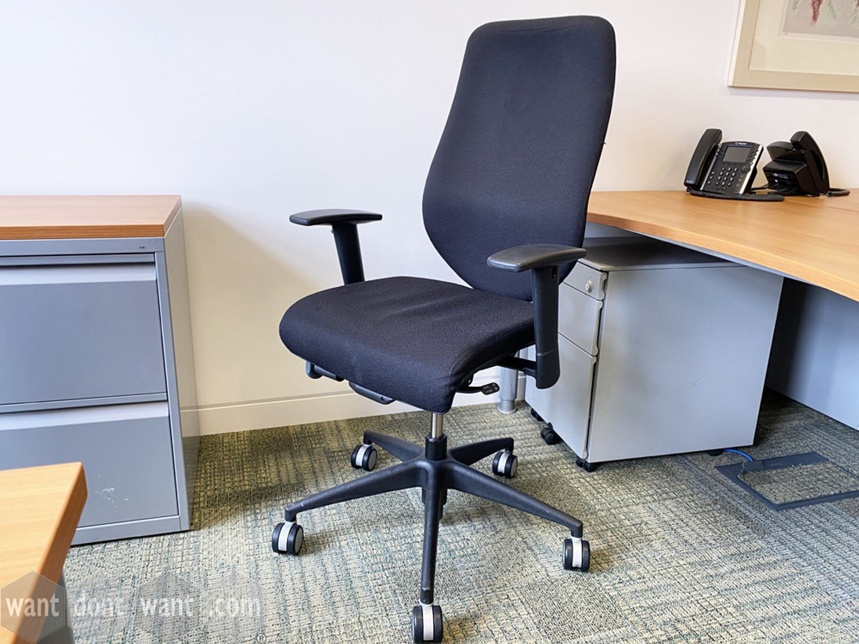 Used Komac task chairs upholstered in black fabric