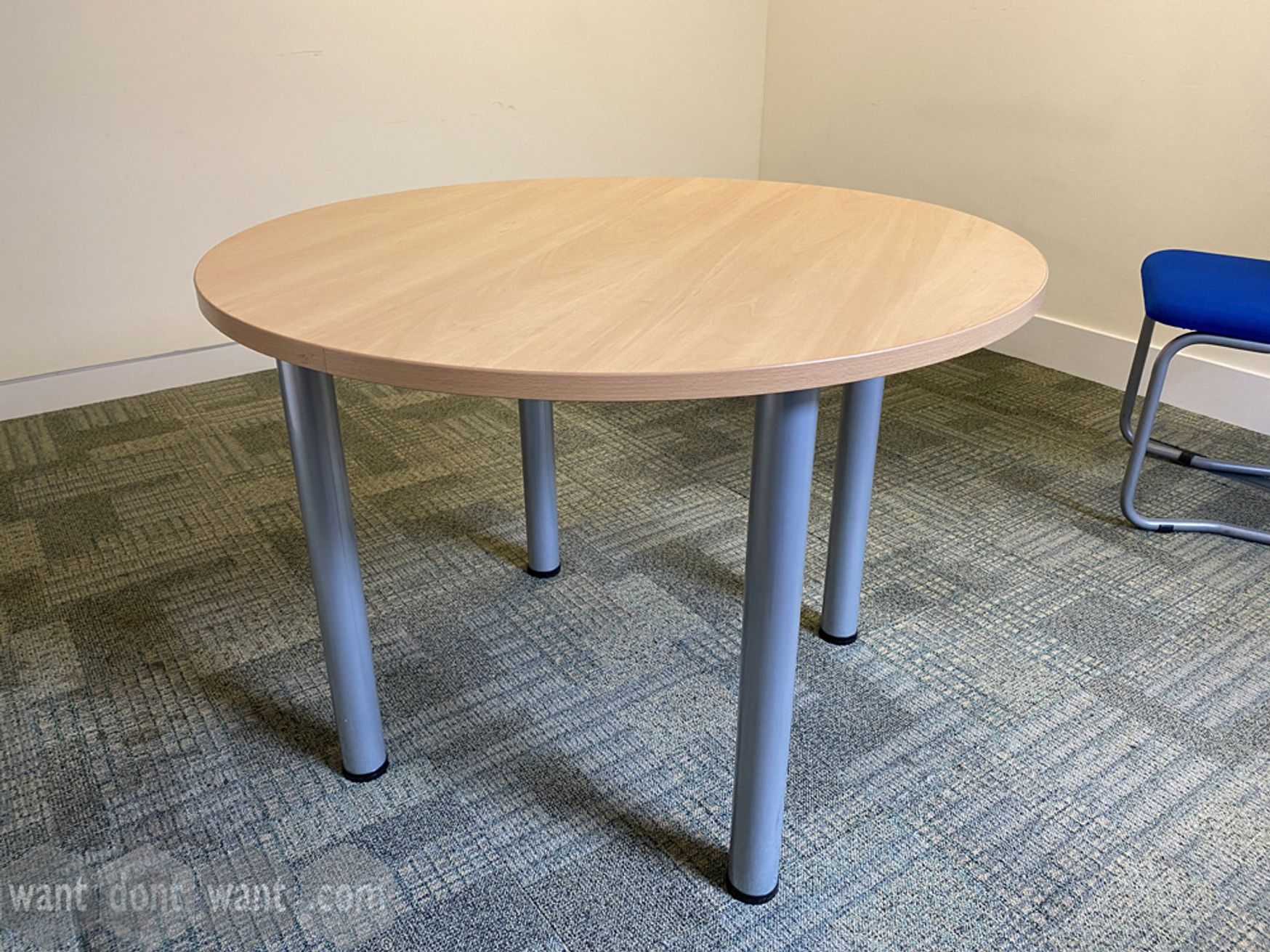 Used meeting table with oak top and grey tubular legs (1000mm dia)