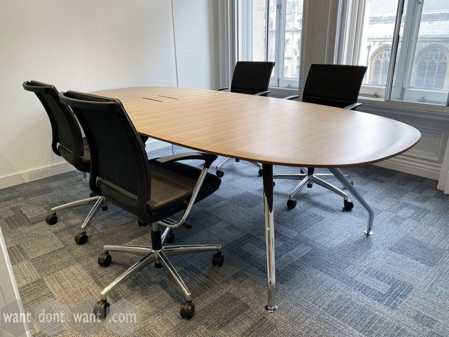 Used modern meeting table in light walnut veneer with splayed chrome legs