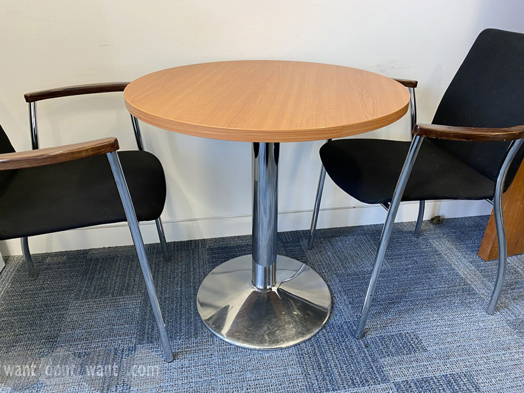 Used circular meeting tables with beech top and chrome column base. 700mm dia