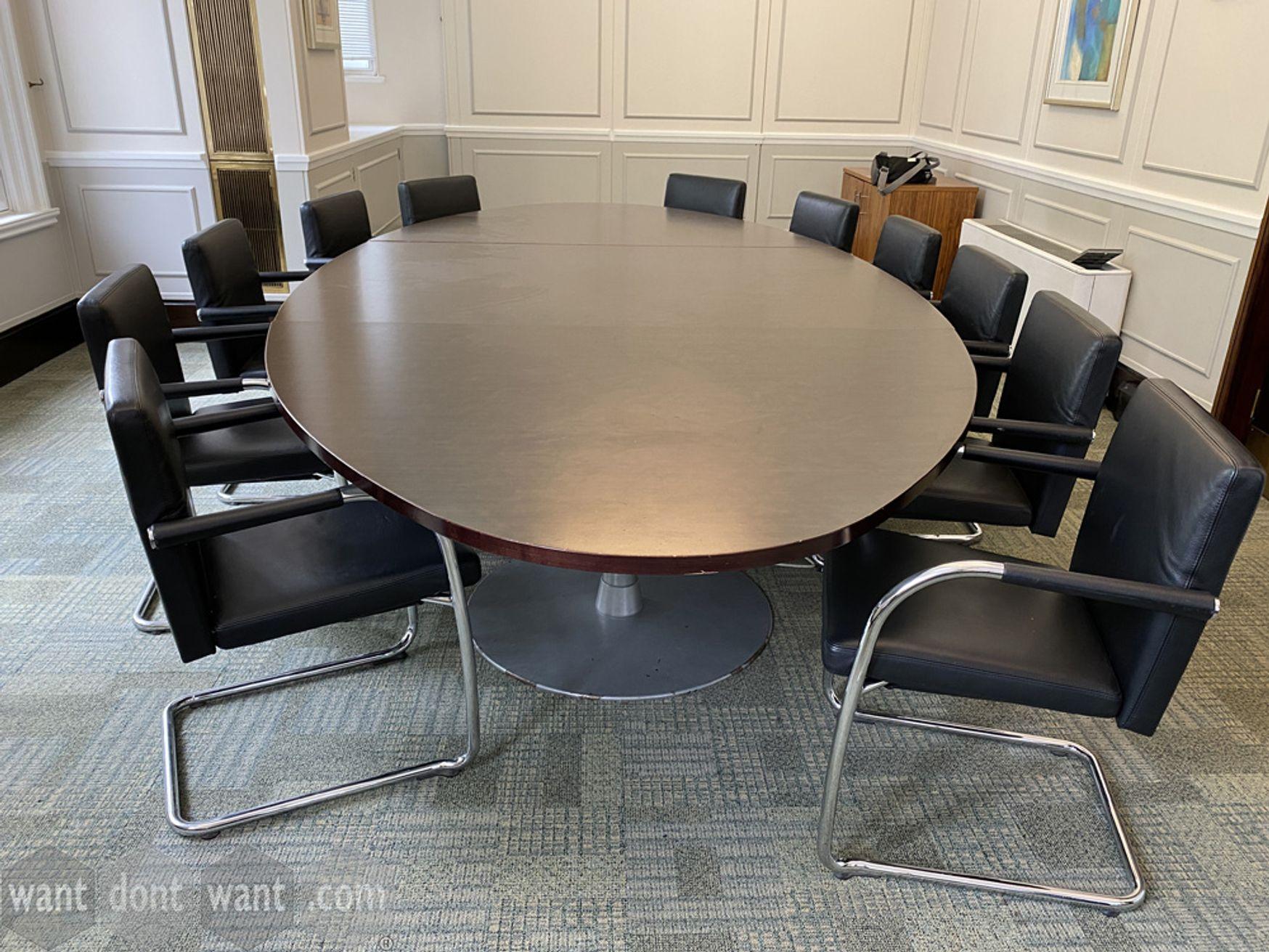 Used 3600mm dark mahogany oval boardroom table to seat 14 people.