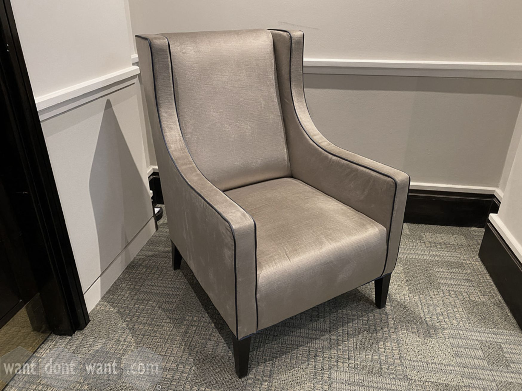 Used high quality armchair with black piping on velvet style fabric