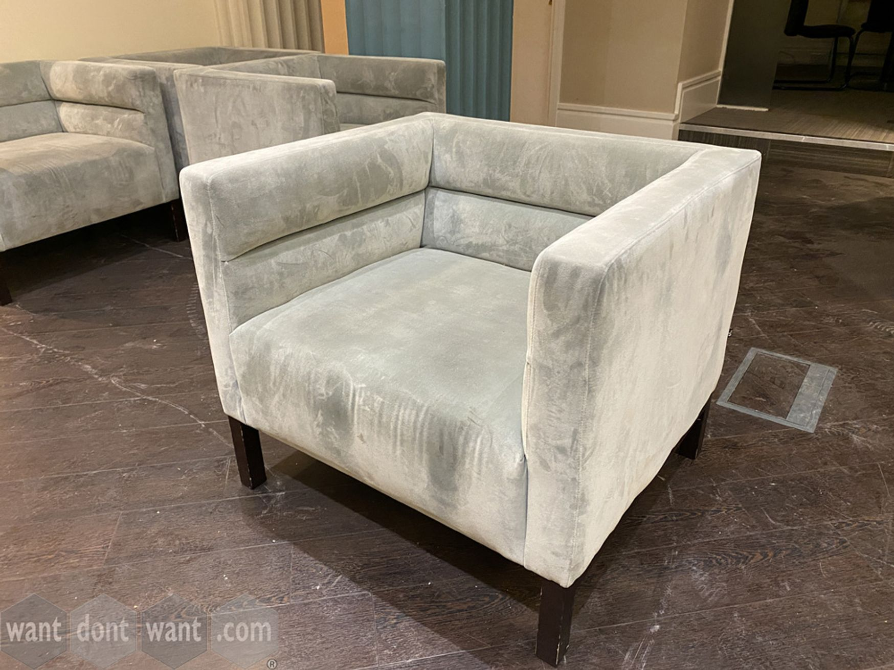 Used contemporary armchairs upholstered in silver suede-look fabric.