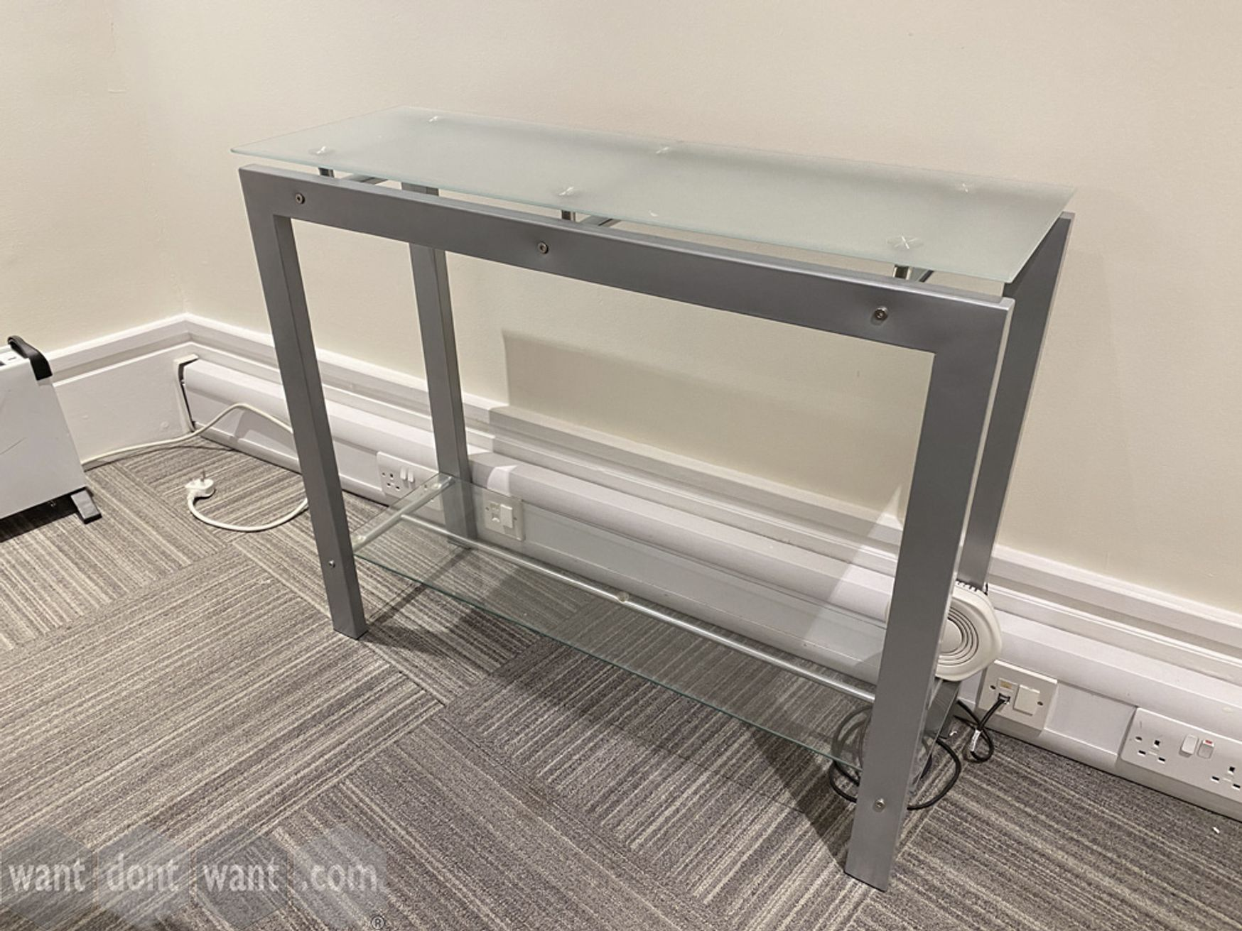 Used glass top console table with steel frame.