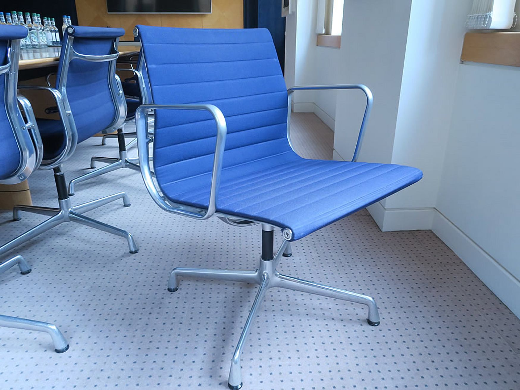 Genuine Vitra 'Aluminium Group' EA108 chairs designed by Charles & Ray Eames.