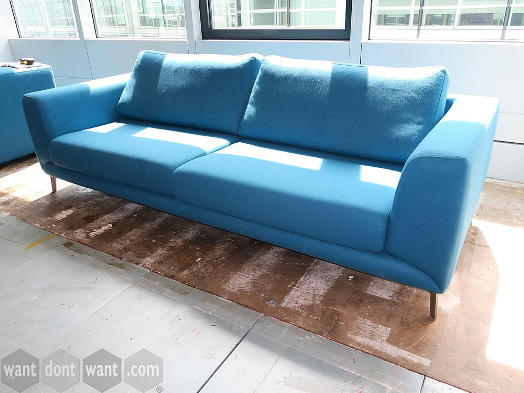 Used BoConcept sofa upholstered in blue fabric.
