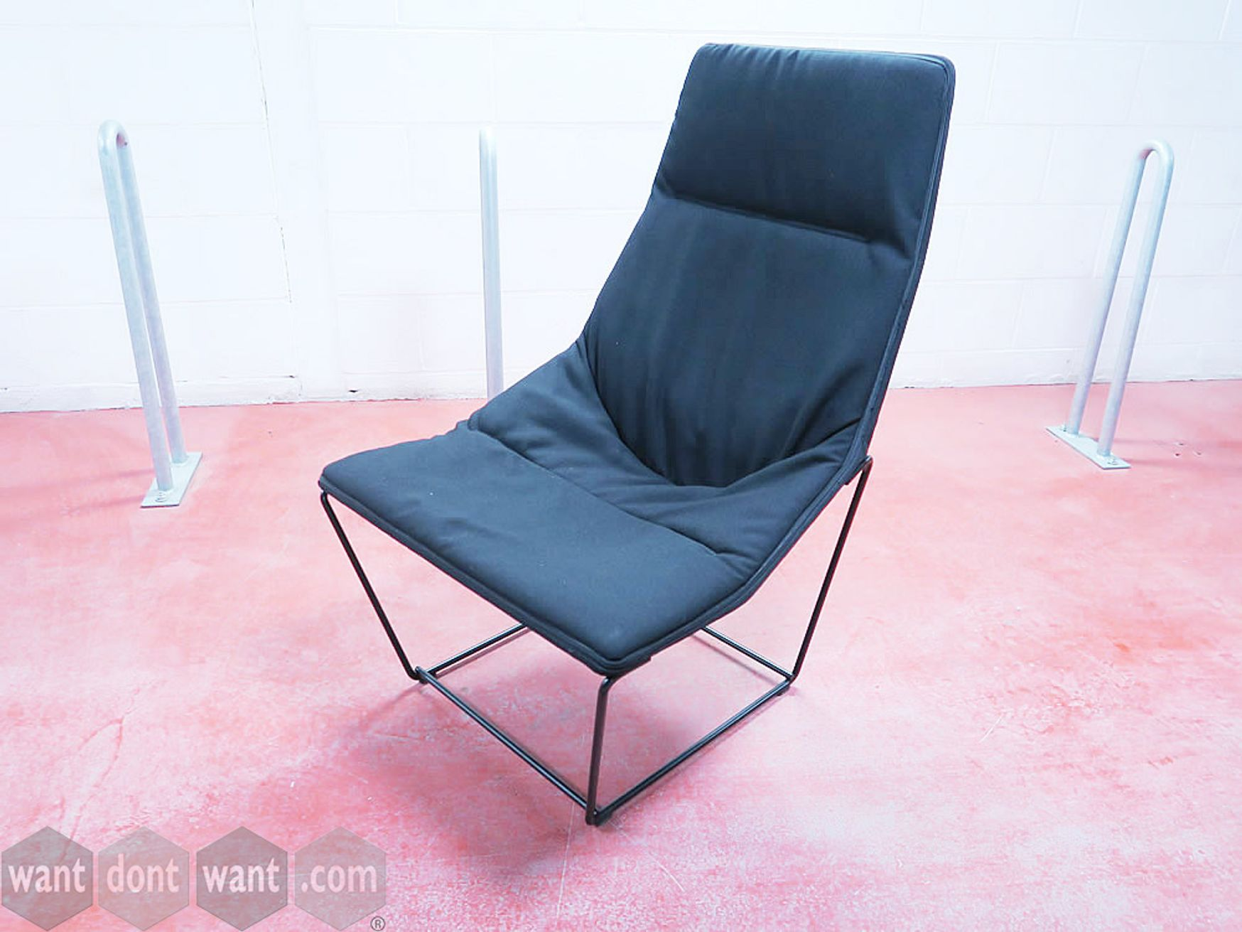 Used Viccarbe 'Ace' lounge chair upholstered in black fabric with black steel base