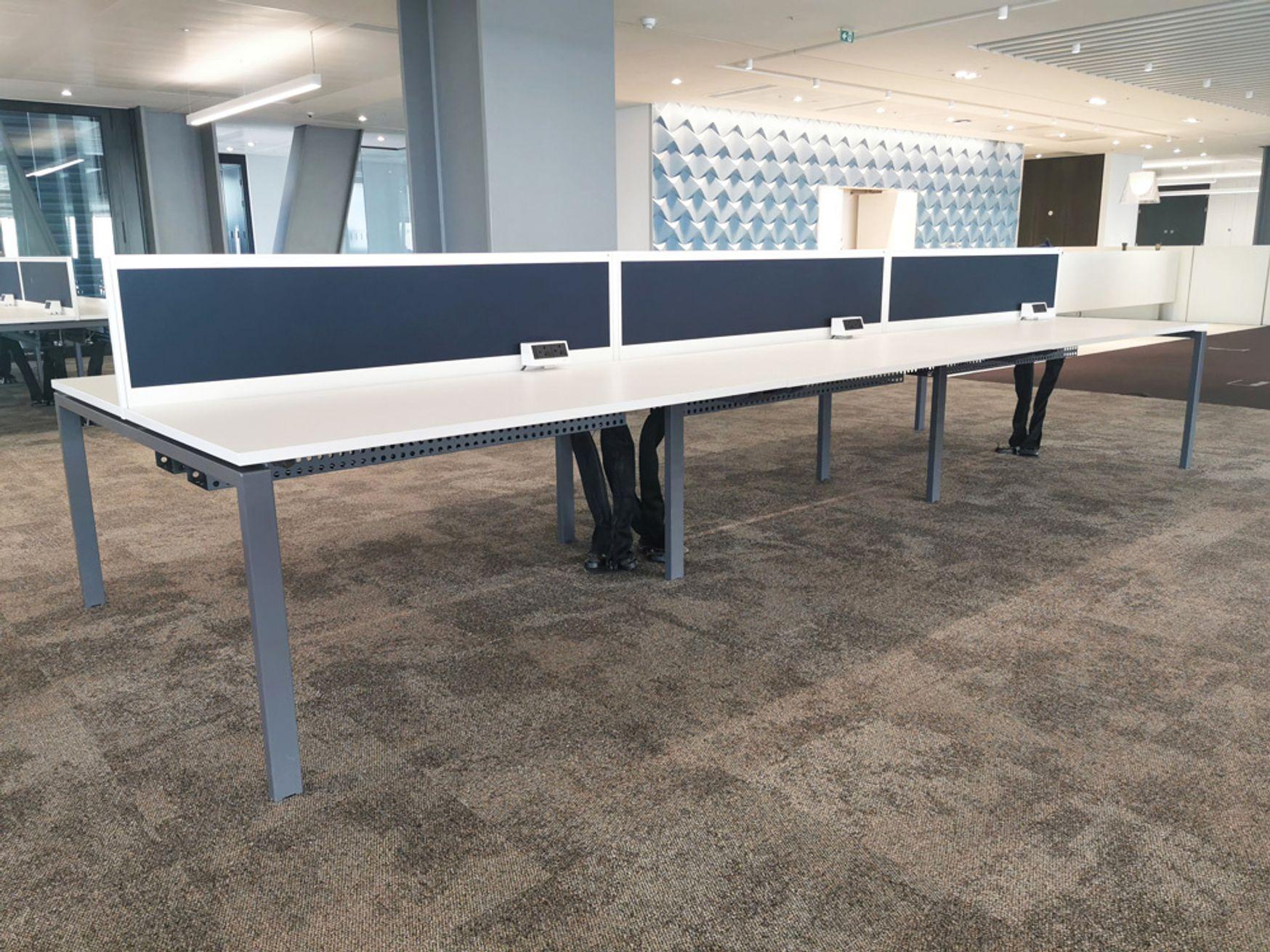 12 x 6-person sliding-top Task 'Team2' white bench desks with dividing screens.