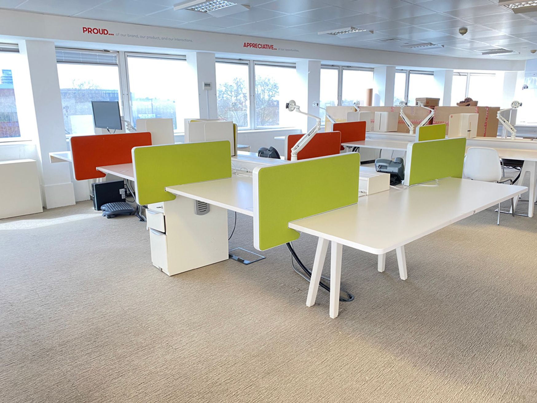 Used Vitra 6-person 'Joyn' desks with an additional extension table to one end. Mixed sized desk widths.
