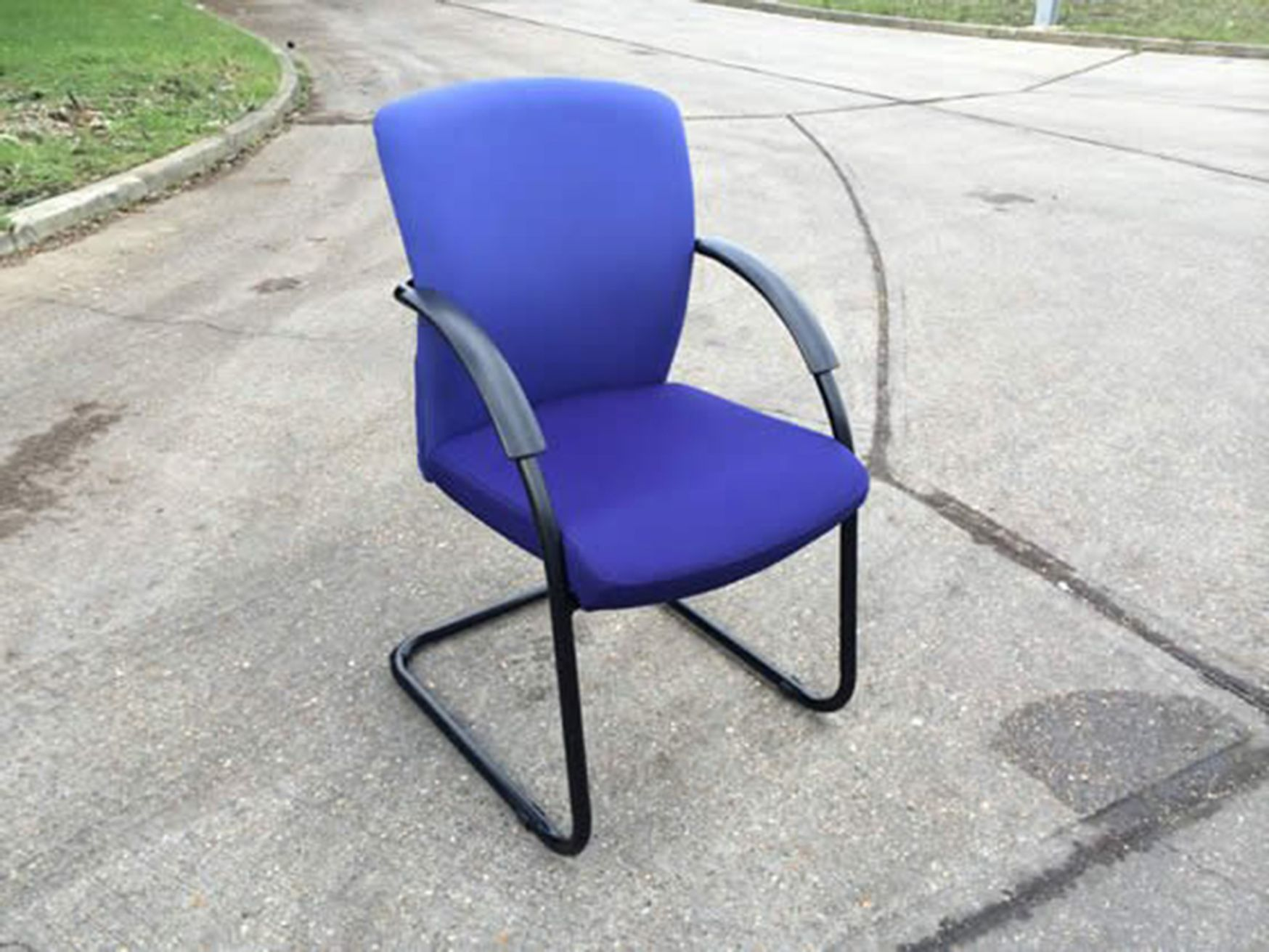 Modern meeting chairs with light purple back/dark purple seat. Black cantilever frame.
