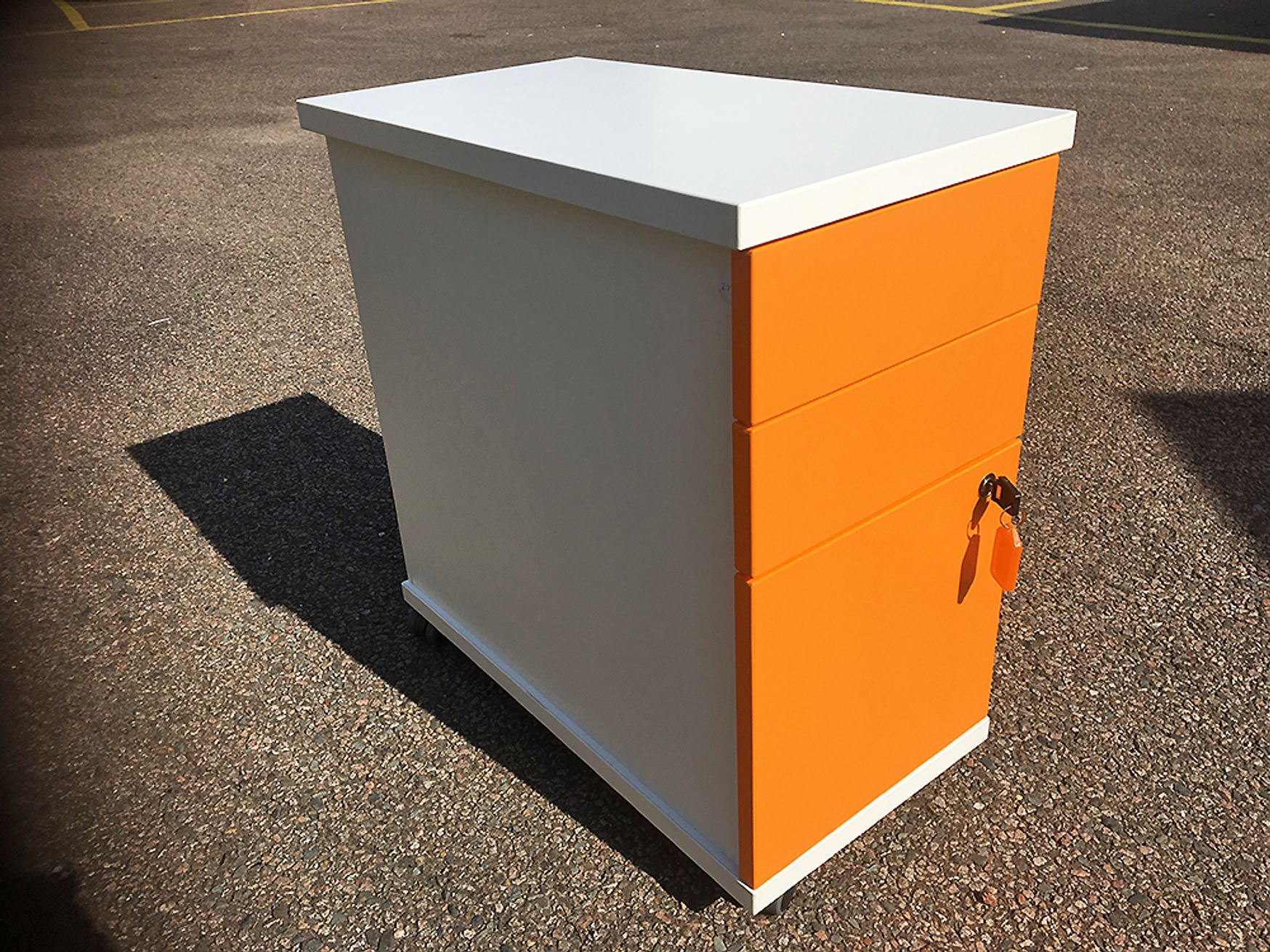 Used Slim-line 3-drawer pedestals with white carcass and orange drawer fronts Dimensions: 320mm wide x 580mm deep x 600mm high