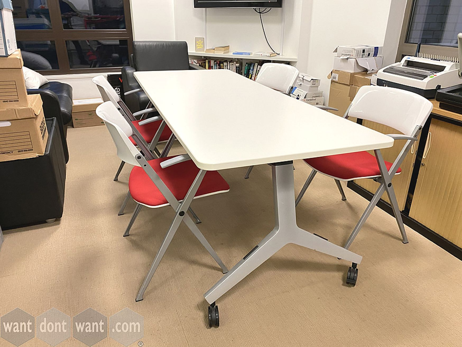 Smart used white table on silver legs with castors