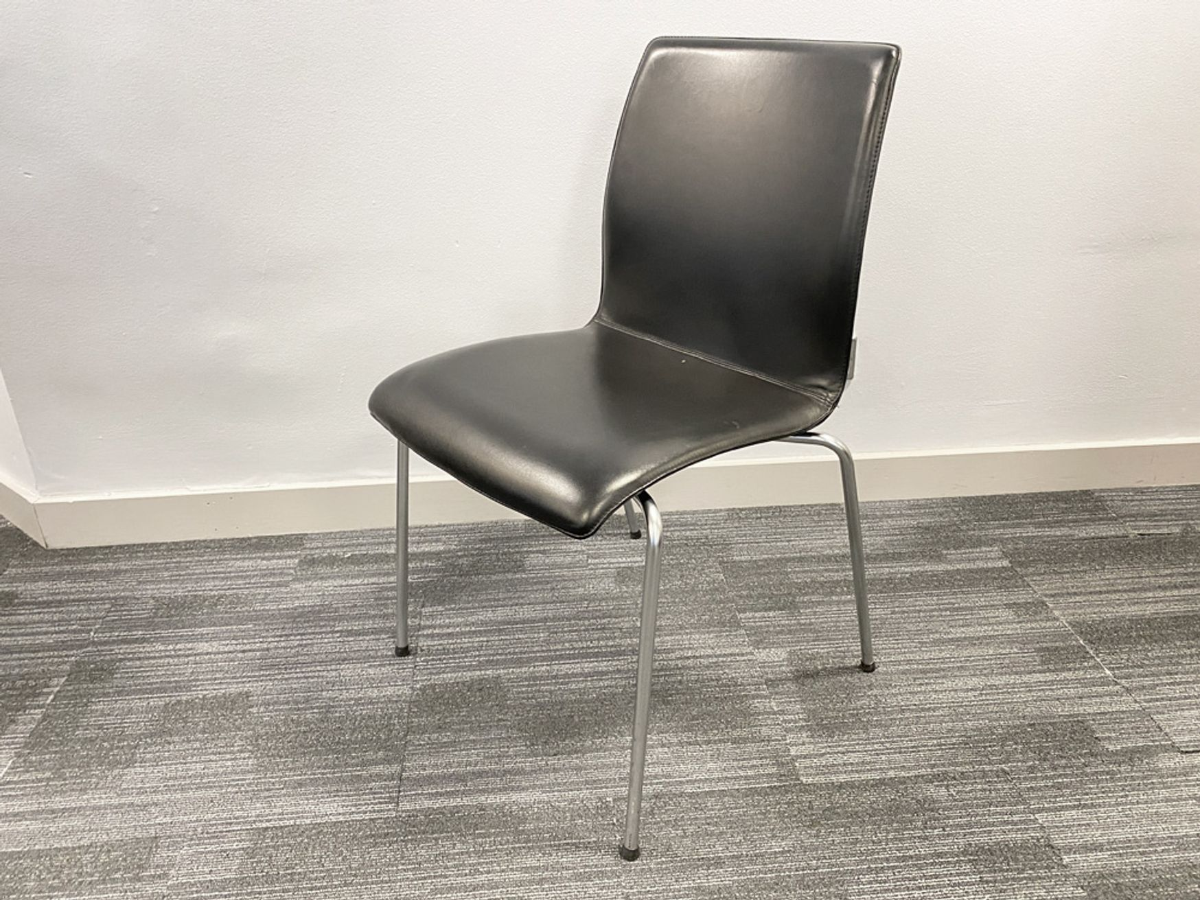 Used black leather stacking chairs with chrome legs