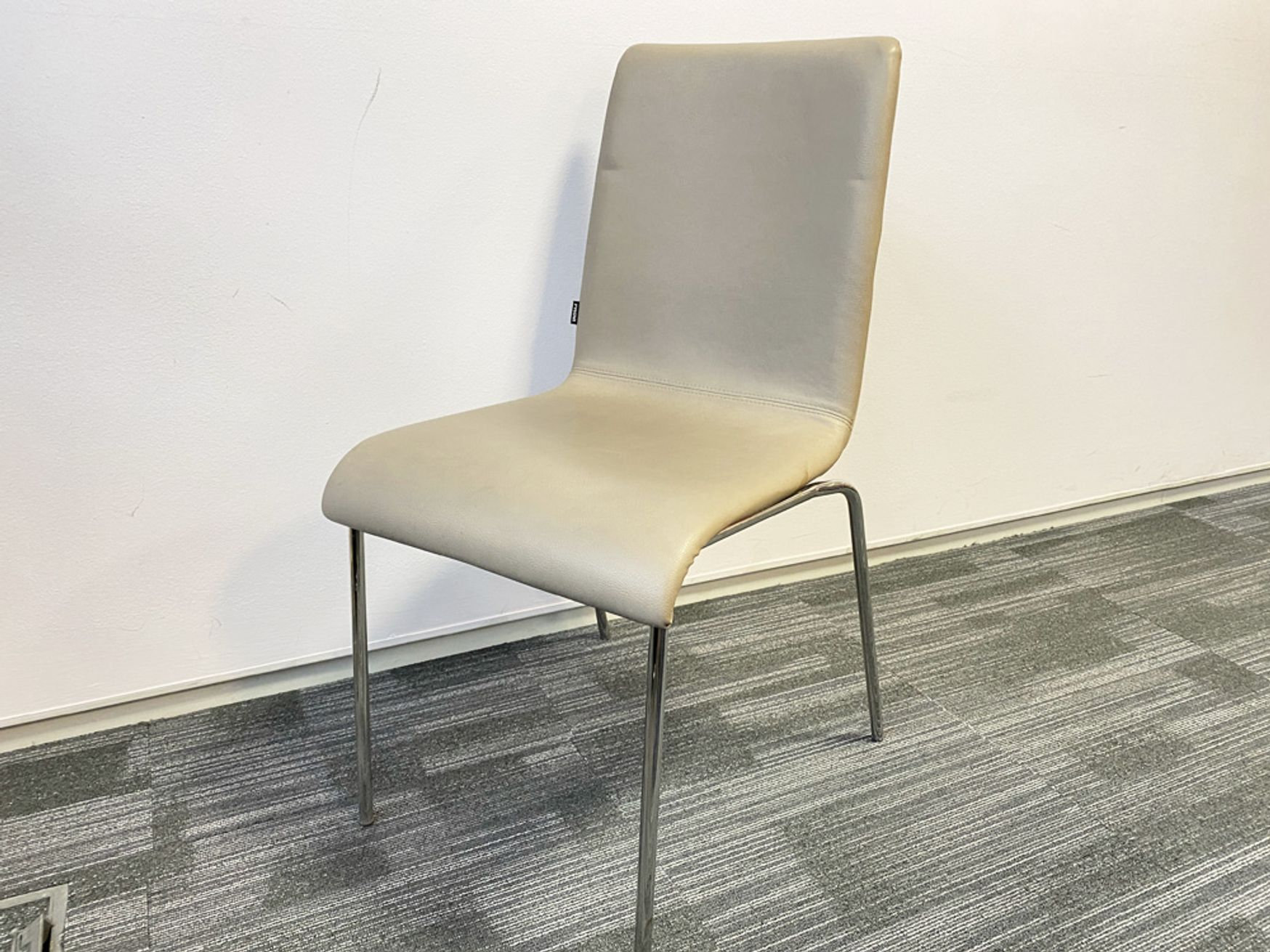 Used 'Frovi' stacking chairs upholstered in cream leather with chrome legs