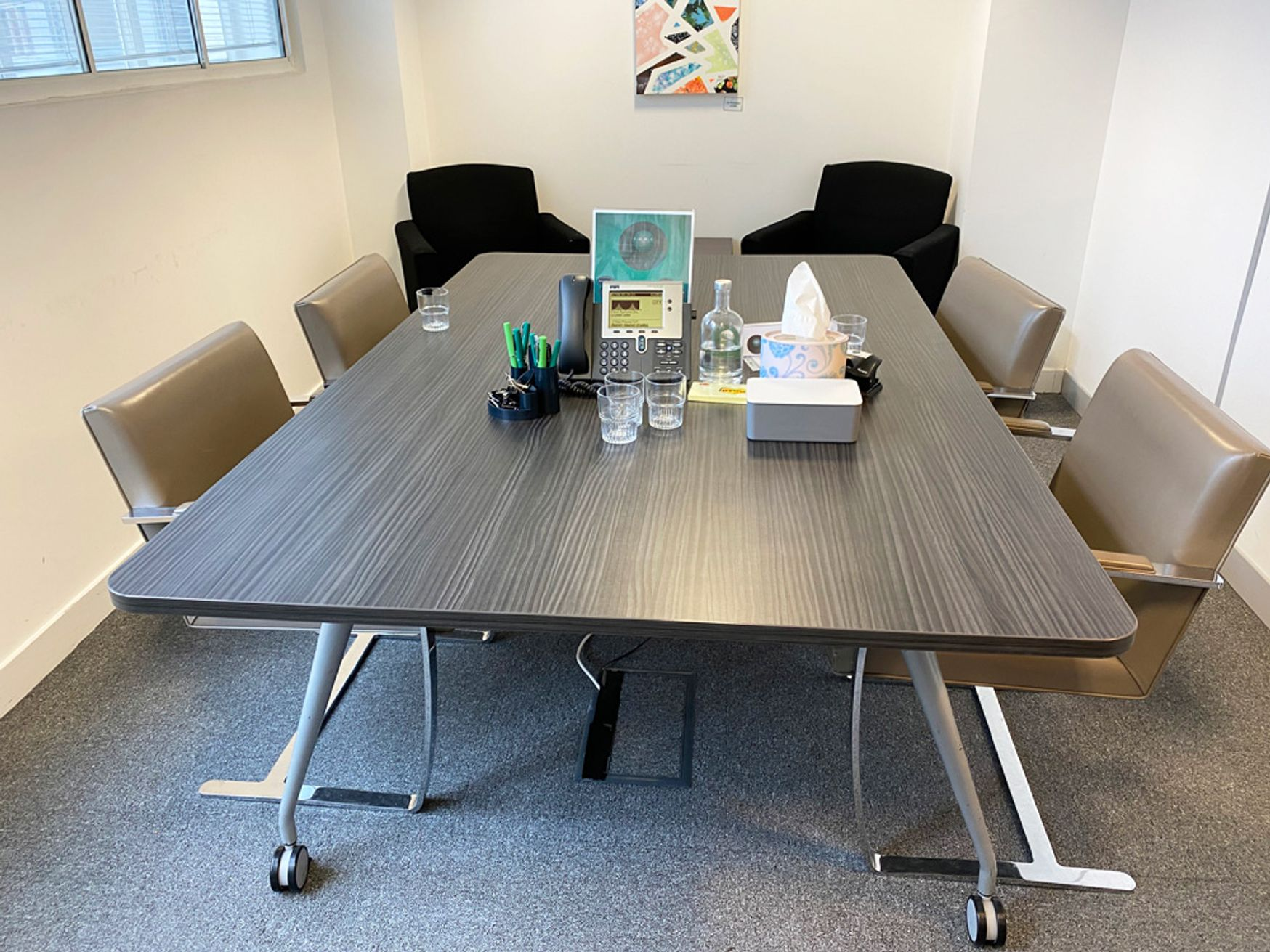 Used meeting table finished in a Zebrano Negro mfc. 2000mm w x 1250mm d
