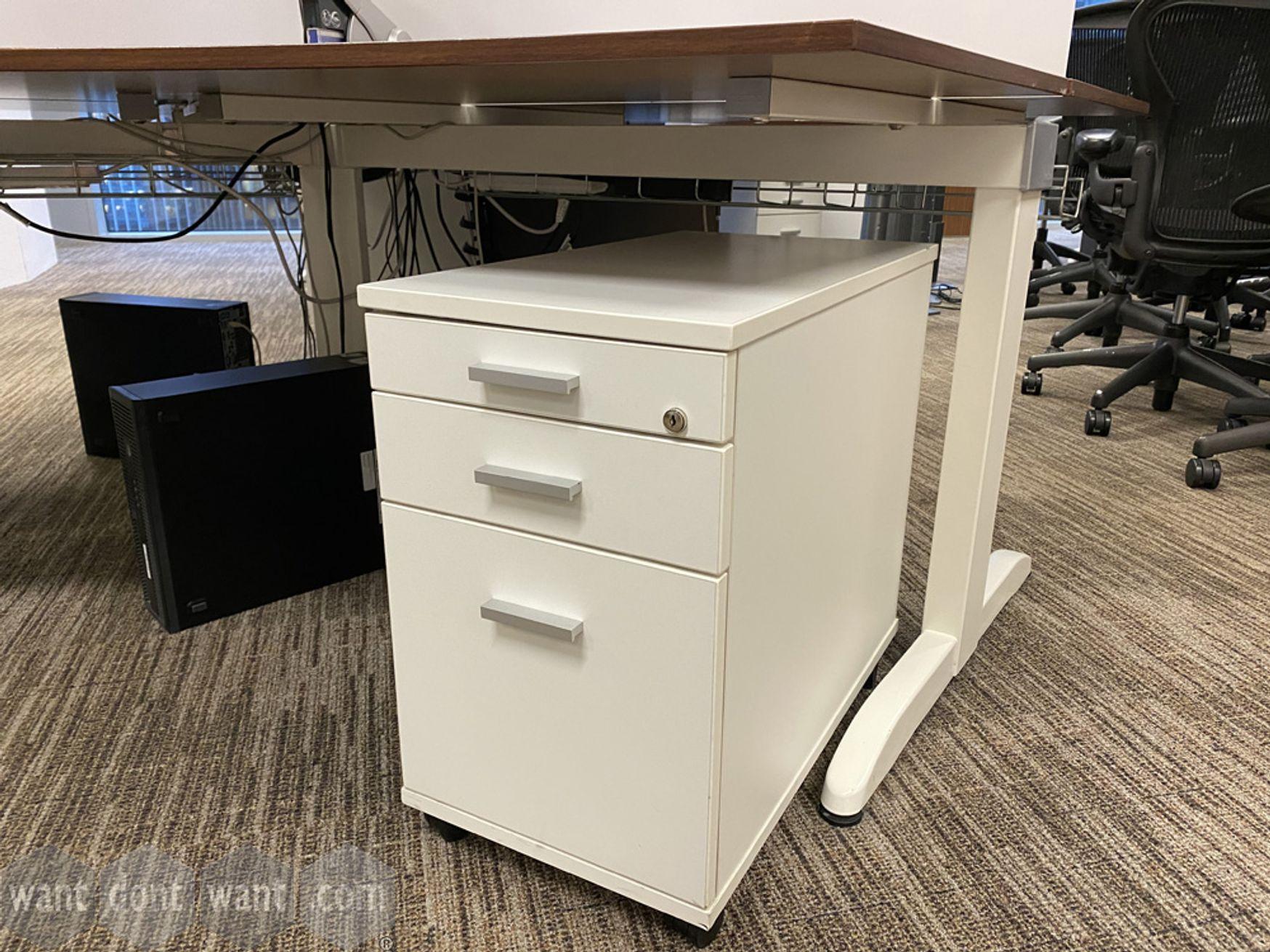 Used white slimline under-desk mobile pedestals