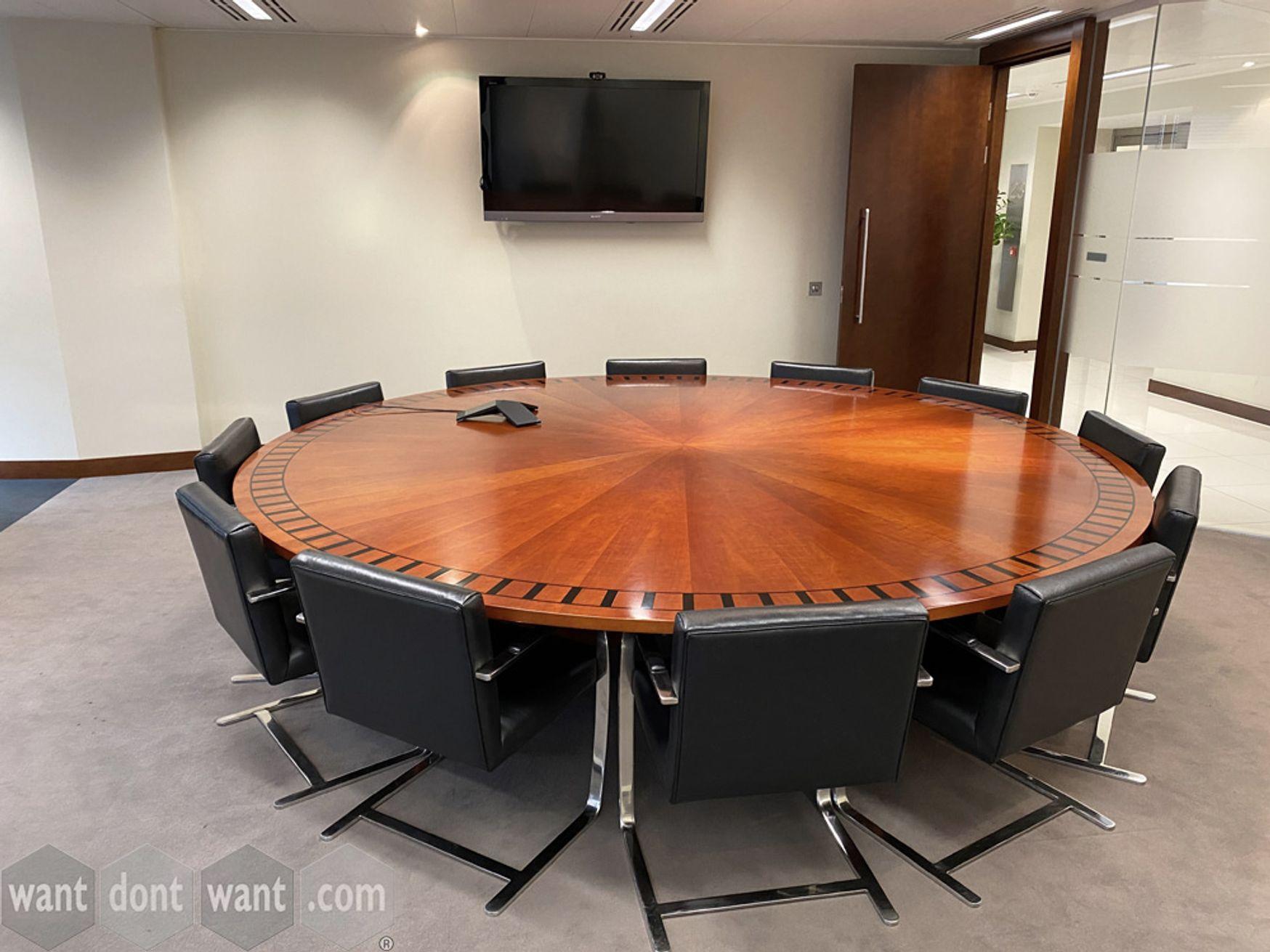 A magnificent circular boardroom table in cherry radial veneer with ebony inlay