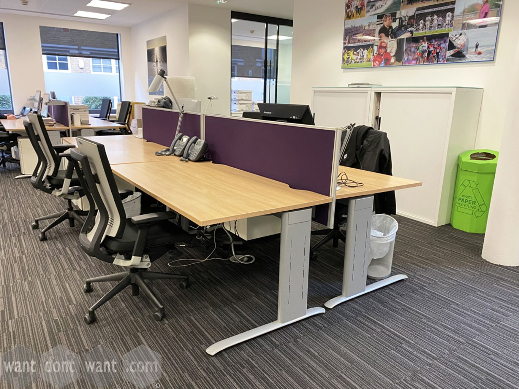 3 x Modern 4-person bench desks with dividing purple fabric screens.