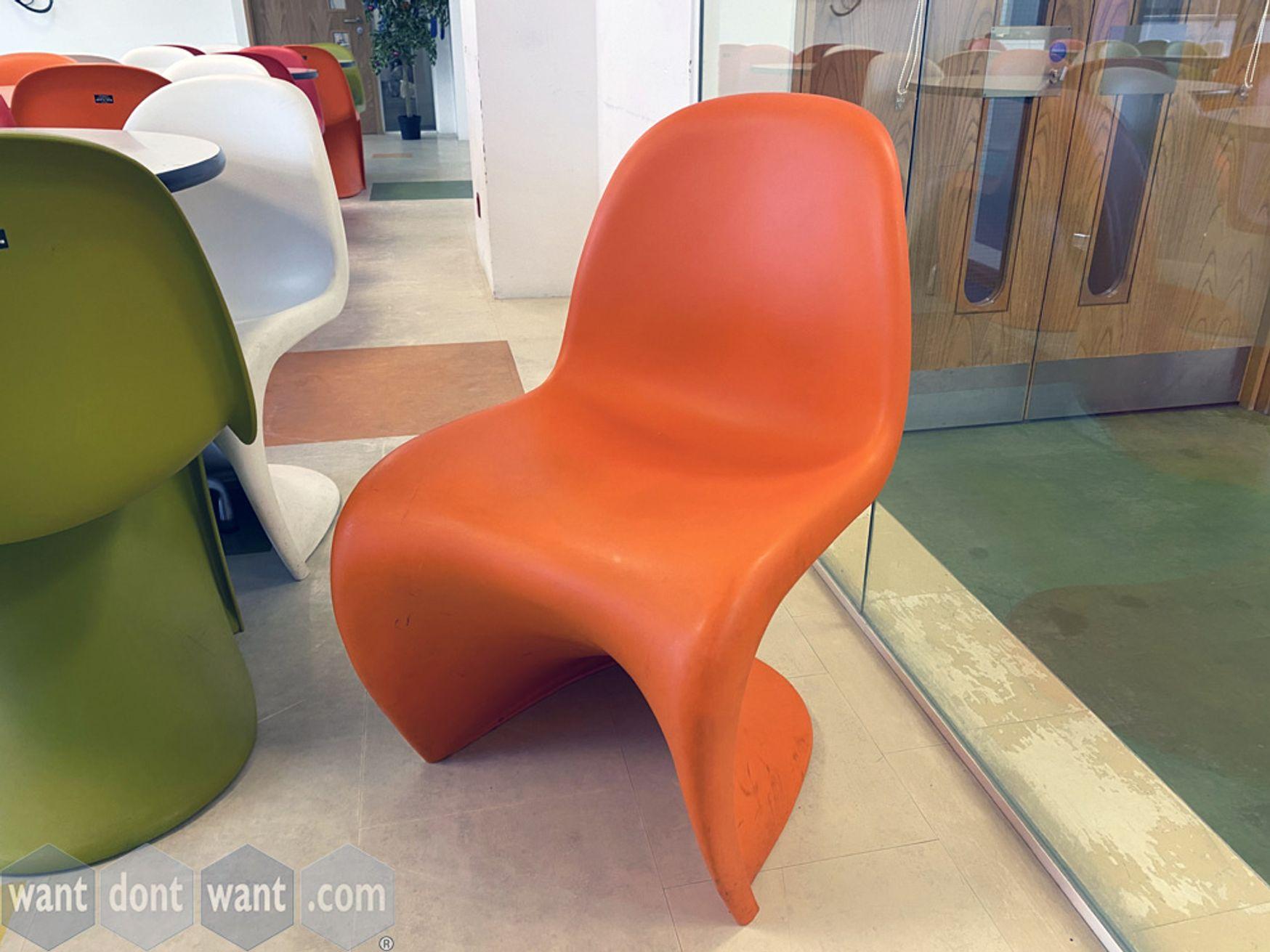 Used iconic design Vitra 'Panton' chairs in orange.