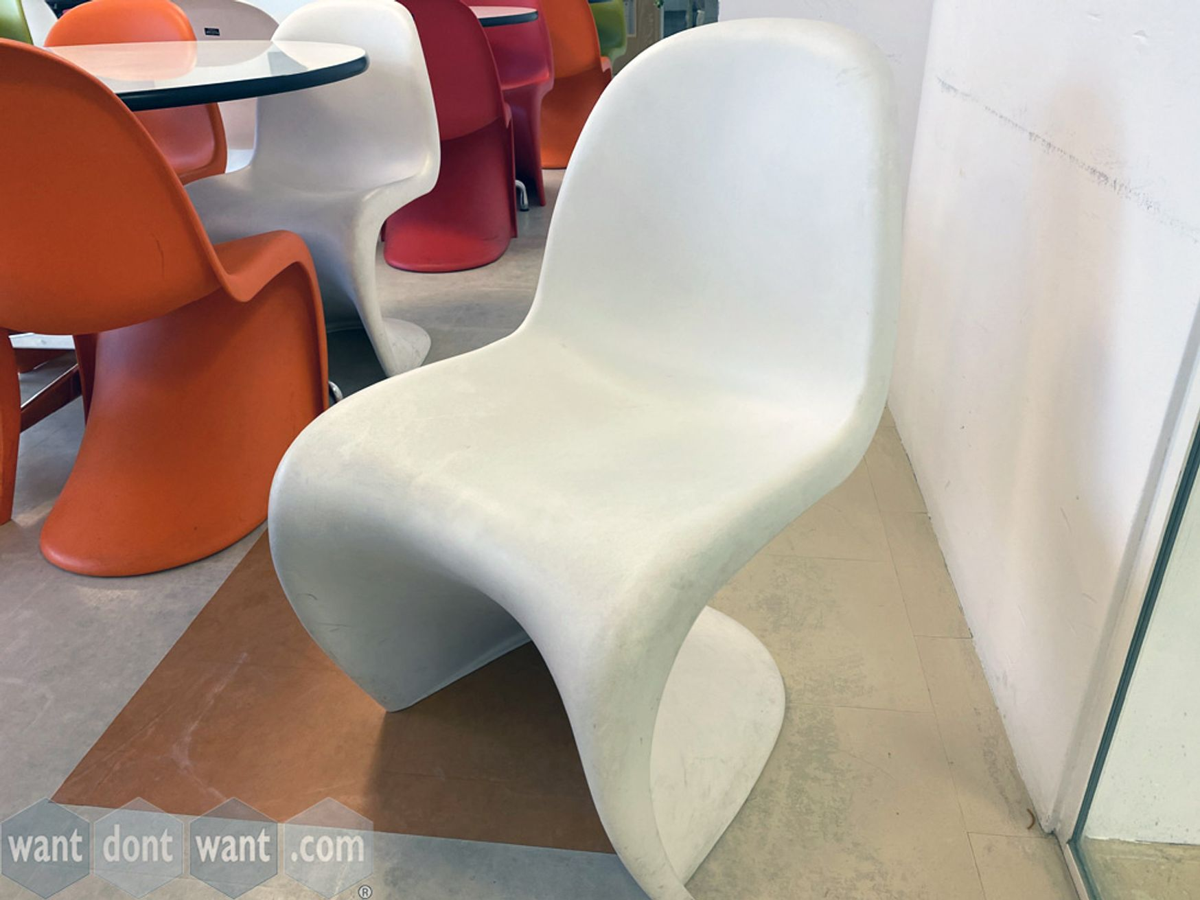 Used iconic design Vitra 'Panton' chairs in white.