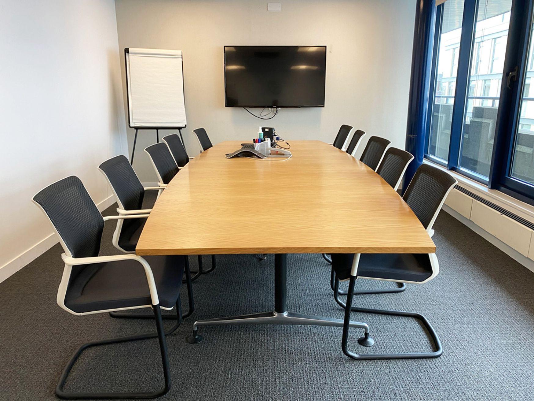 Used oak veneer barrel-shaped meeting table