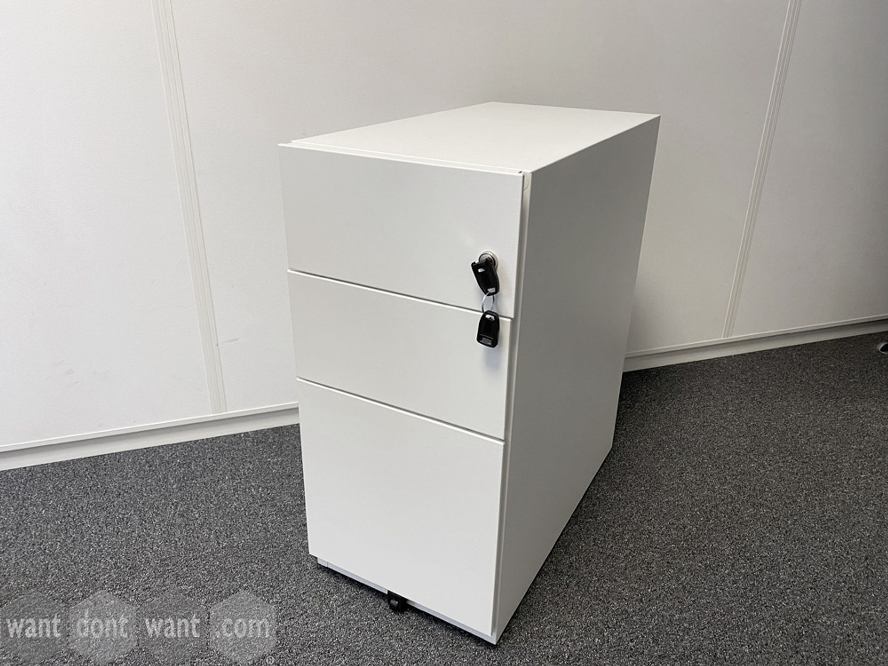 Used white slimline 3-drawer pedestals with 2 x shallow drawers and 1 x filing drawer.