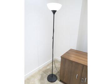 Modern up-lighter with black stem and base.