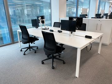 Used smart modern 'Albion' 4-person white bench desks in very good condition