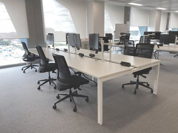 Used smart modern 6-person white 'Albion' bench desks in very good condition.