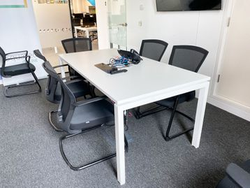Used white 'Albion' meeting tables with flip-over power/data module