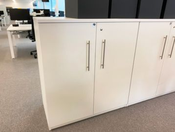 Used 1000mm wide white double door storage cupboards with contemporary design handles