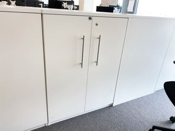 Used 800mm wide white double door storage cupboards with contemporary design handles.