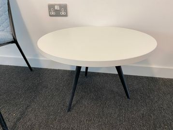 Used low white coffee tables with black splayed legs.