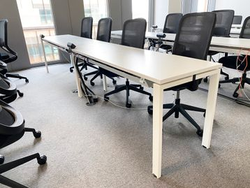 14 x 4-person modern white training tables (56 x positions) with cable trays.