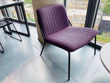 Used 'Sling' lounge chairs in purple coloured ribbed fabric with black metal legs.