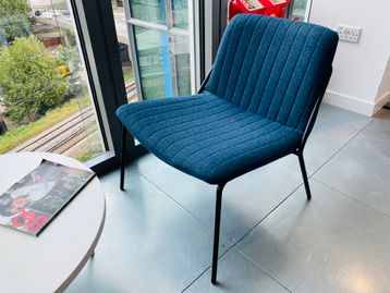 Used 'Sling' lounge chairs in petrol blue ribbed fabric with black metal legs. Very popular style of chair.