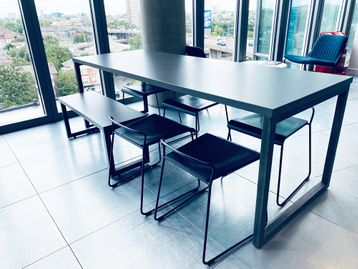 Urban style used 'Mix' cafe tables with grey tops an raw steel legs