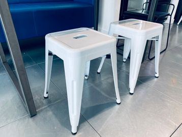 Used low white metal stalls based on the design of the Tolix stool