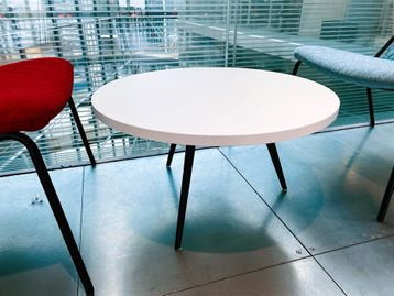 Used low white coffee tables with splayed black legs